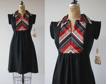 vintage 1970s dress / 70s black dress / 70s empire waist dress / 70s day dress / 70s tie back dress / 70s chevron bib dress / medium large