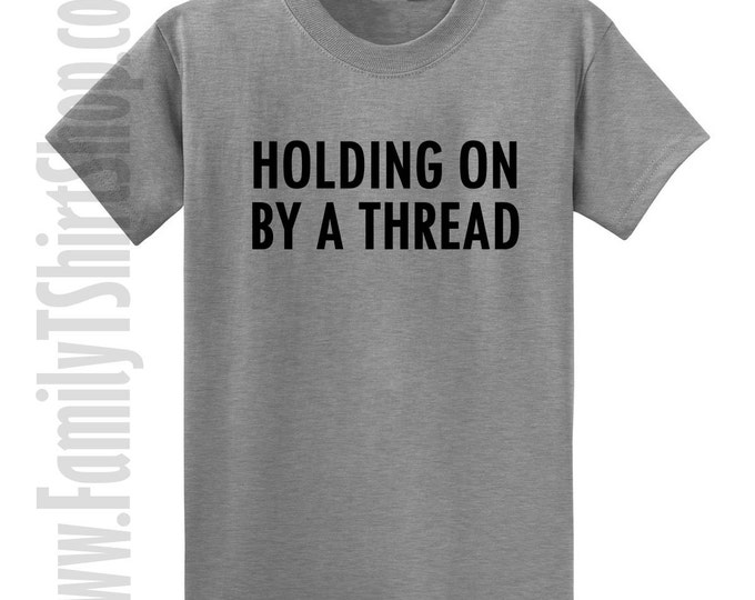 Holding On By A Thread T-shirt