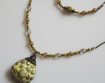 Sweet Like Honey, Hard Like Rock - Creamy Yellow brass wrapped ceramic pendant necklace in two parts