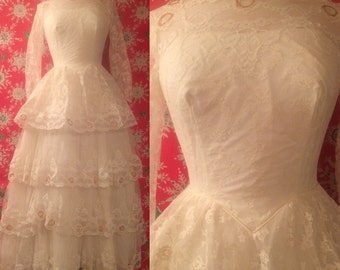 Vintage 1950s White Lace Wedding Dress with Tiered Tulle and Lace Front by Bridallure Inc