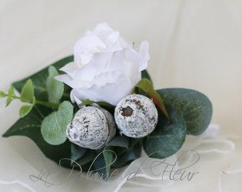 Buttonhole, boutonniere. White rose, grey gumnut men's buttonhole, boutonniere with Australian native foliage.  Groom, groomsmen, wedding