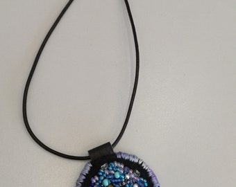 Turtle on making hand embroidered necklace