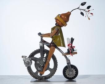 Postman - sculpture in metal