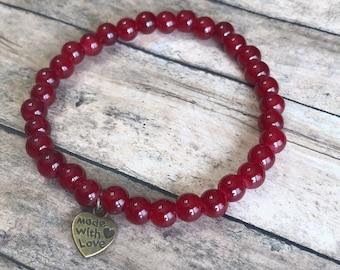 Red beaded elastic bracelet. Womens bracelet. Beaded bracelets. Red bracelet.