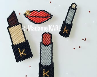 Brooch has red lips