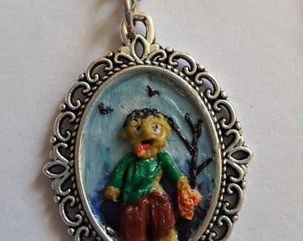 Gory zombie eating human flesh scene pendant.... perfect for halloween!