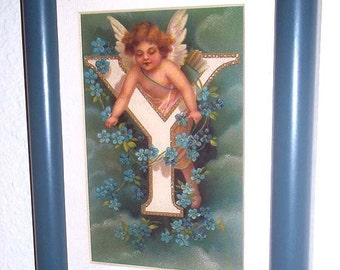 Wonderful  Framed Print of An Angel Decorating the Letter Y With A Garland of Flowers