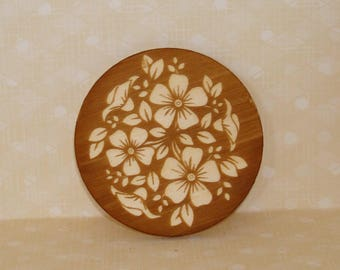 white wooden 337 and engraved floral medallion placed anywhere