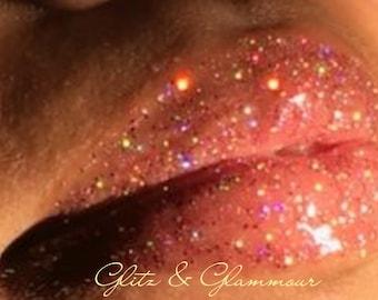 All handmade glitter lip glosses using all natural 100% vegan ingredients.