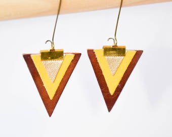 Earrings are made of leather Brown geometric graphic