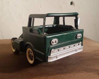 Vintage green structo truck