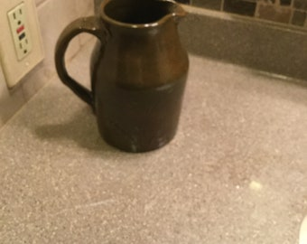Handmade stoneware pitcher in olive green