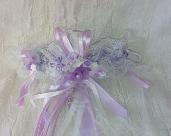 Purple and white bridal garter