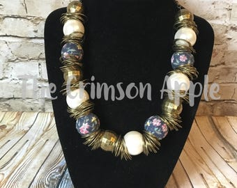 Brass jumpring, pearl, floral beaded necklace