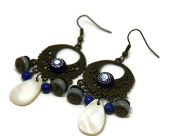"""Earrings """"My damaged Immersion"""", bronze metal, glass and shell"""