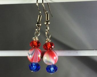 Red & blue Swirls with matching crystals. French Hook.