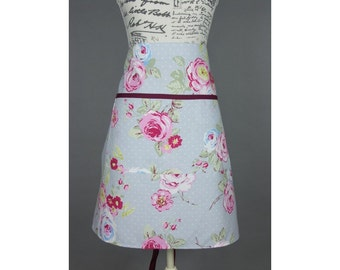 Adult half apron - made with a pale blue and white spot fabric with a rose and leaf design