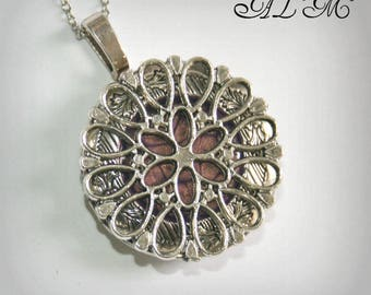 Locket necklace with flower and purple beaded (p) background