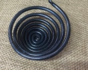 Spiral tea light holder