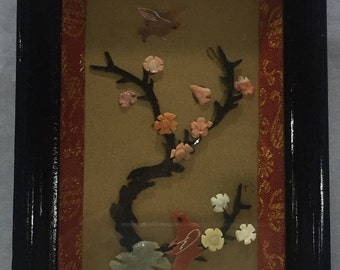 Painting in semiprecious stones (coral, jade and agate) depicting a branch of cherry and birds
