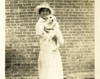 Vintage photo 1917 Young Pretty Woman Holds White Dog Bullseye Look on Roof