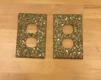 Gold glitter outlet covers. (Set of two)