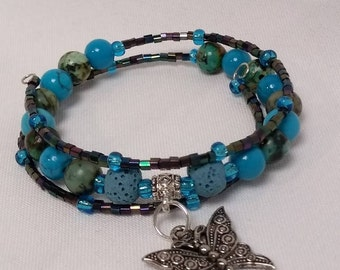 Essential Oil Diffuser Memory Wire Bracelet of Turquoise and Lava Rock Beads with Glass Accent Beads and Butterfly Charm