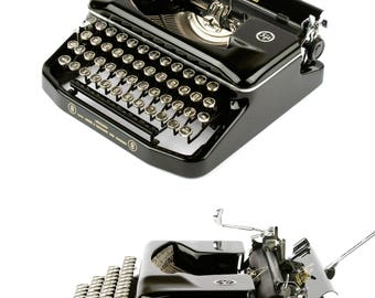 Erika 8 -  working typewriter in excellent condition - 50s - portable -  vintage typewriter with glass keys