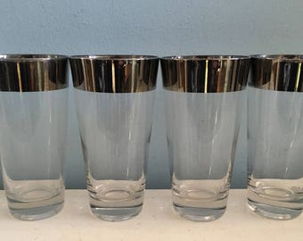 4 piece silver rimmed tall glassware set, in the style of Dorothy Thorpe.
