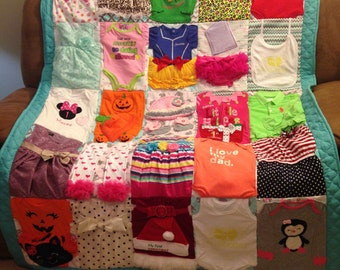 Custom memory quilts made from children's clothing baby clothes quilt.