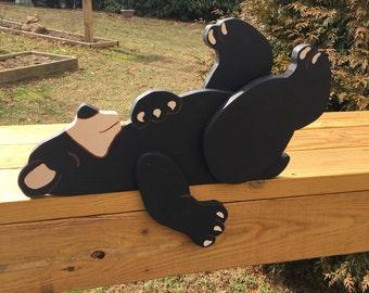 Black bear fence sitter