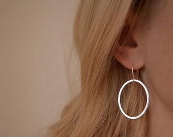 Silver hoop earrings. Minimalist sterling silver oval dangle earrings. Silver earrings. Textured. Silver jewellery. Handmade