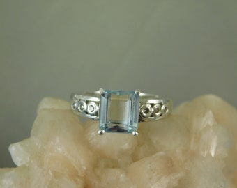 2.73 ct. Emerald Cut Aquamarine and Diamond Ring High Polished Sterling Silver