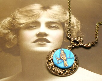 Wee BIRD BUTTON necklace, Vintage 40s glass on brass chain. Button jewellery.