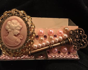 Womens Cameo business card holder, display stand