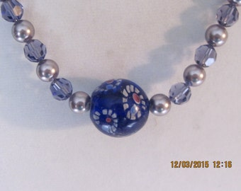 21 inch swarovski tanzanite pearl and crystal and silver necklace with flowered bead center