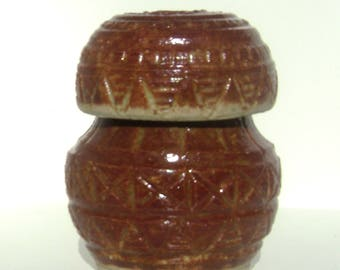 Hand made and carved corked and lidded jar