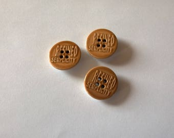 Set of three porcelain Brown buttons