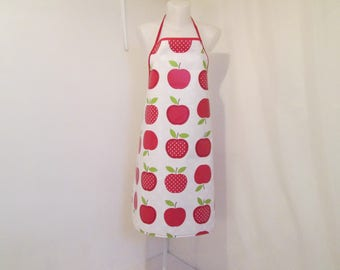 Apron woman in white oilcloth with red apples
