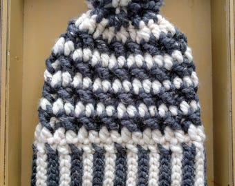 Cream and gray pompom hat with handmade puff on top. Handmade, crocheted, sightly oversized and warm!