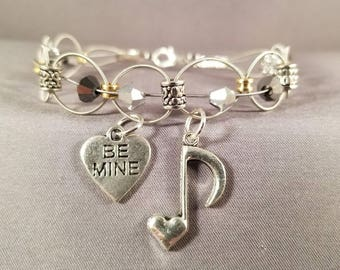 """Woven Guitar String Bracelet with Swarovski crystals """"Eighth Note Heart"""""""