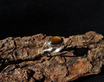 Silver ring set with a tiger eye cabochon