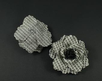 Large 10cm diameter black fabric flower.