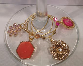 Set of 4 gold and pink wine glass charms