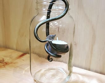 Hand forged iron mason jar tea light holder