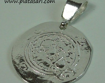 Persian silver coin pendant.