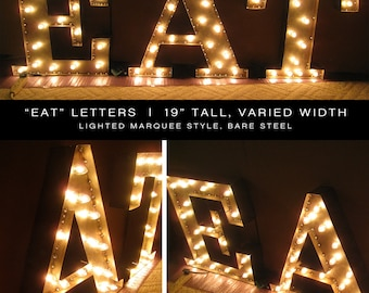 EAT SIGN, marquee lights, bare steel