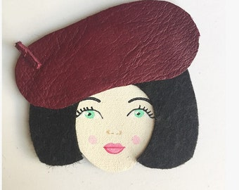 Face with raspberry leather Hat pin