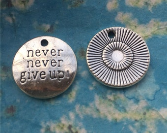 Heavy and Strong 15 pieces 20mm antiqued silver with the word never never give up round charms findings
