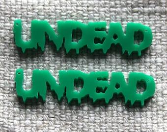 2 x Laser cut acrylic Undead pendants